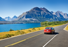 car driving through beautiful landscape
