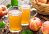 glasses of apple cider and apples