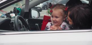little girl at drive thru Santa