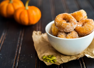 donuts in a bowl with pumpkins